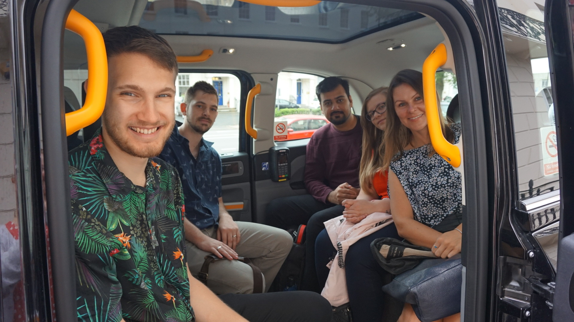 People sitting in a taxi