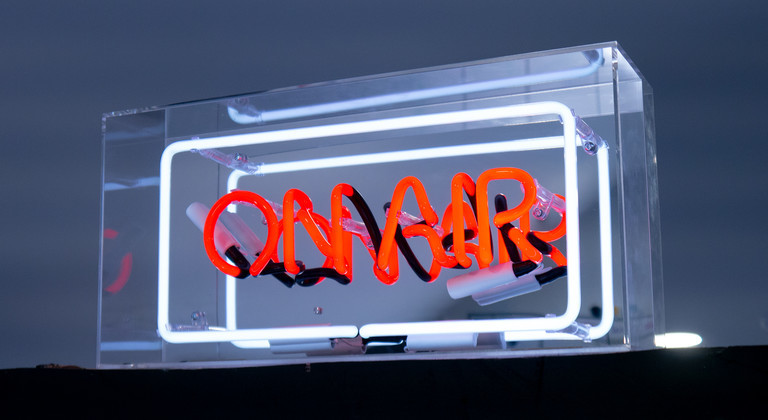 On Air neon sign in a transparent acrylic box